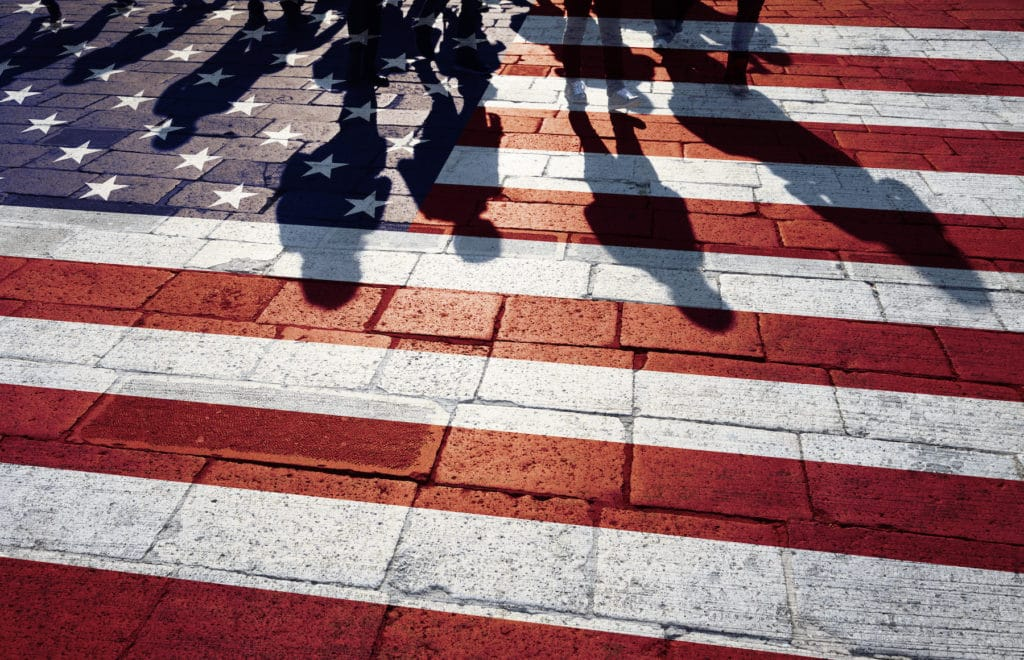 Group of people walking with painted usa flag